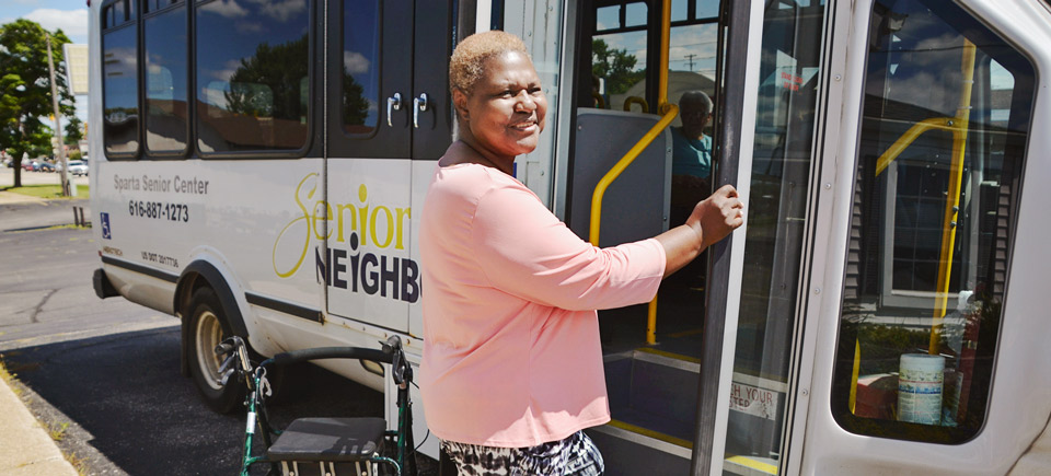 Services Banner - Elderly woman getting on a bus